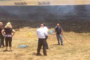 Fires burn in both Rogers and Muldrow on Thursday.