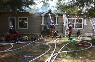 A fire burns a mobile home in Blue Springs Village.