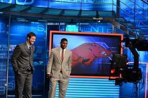 Arkansas quarterback Tyler Wilson and running back Knile Davis in front of the plasma monitor on the SportsCenter set