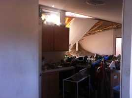 You can see the wall damaged in the Hobbs' kitchen area.