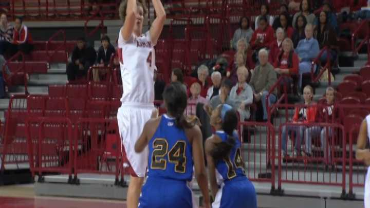Arkansas forward Sarah Watkins squares up for a jumper against Coppin State