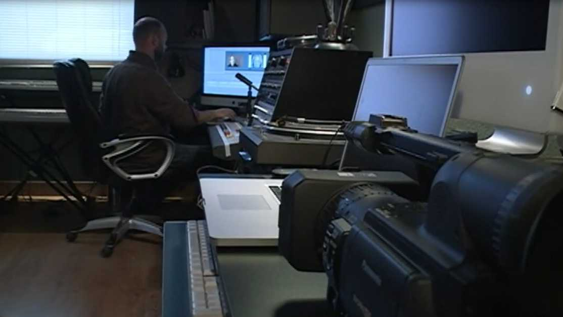 Dan Robinson, owner of Fiery Moon Productions, works on a locally produced documentary at his studio in Fayetteville.
