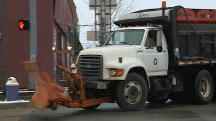 A snow plow truck with the Arkansas Highway and Transportation Dept. turns on a street in Booneville, Ark.