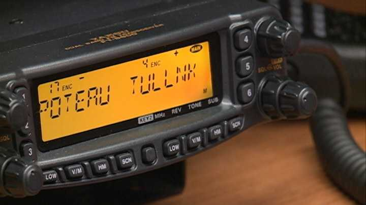 The Tulsa link UHF repeater frequency is displayed on this ham radio.