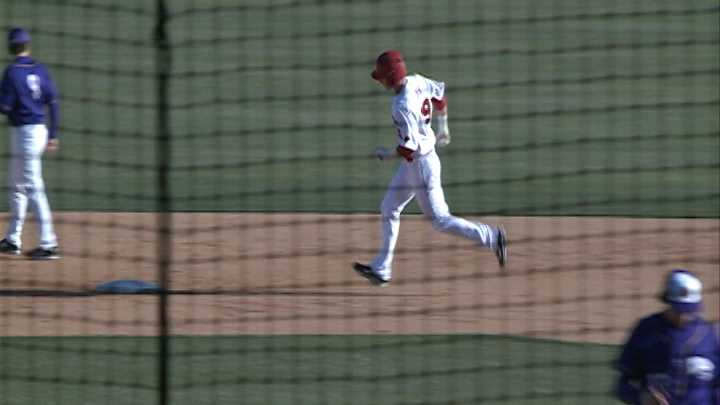 Arkansas 1st baseman Eric Fisher rounds the bases after his 3rd inning home run vs. Western Illinois