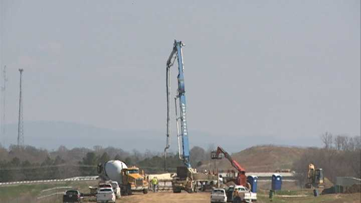 Crews pouring concrete on a section of Interstate 49 in Fort Smith, Ark.