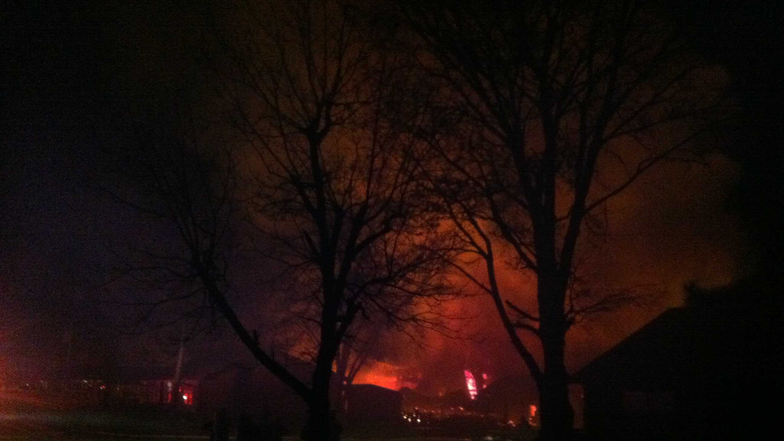 Smoke billowed into the air Tuesday night from the Charleston pallet plant fire.