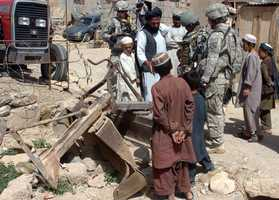 7. Addison1st Lt. Addison Taylor with the Arkansas National Guard talks to a farming equipment dealer in Afghanistan in 2010.