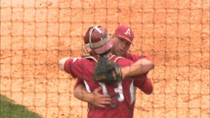 Arkansas pitcher Colby Suggs and catcher Jake Wise embrace after a victory.