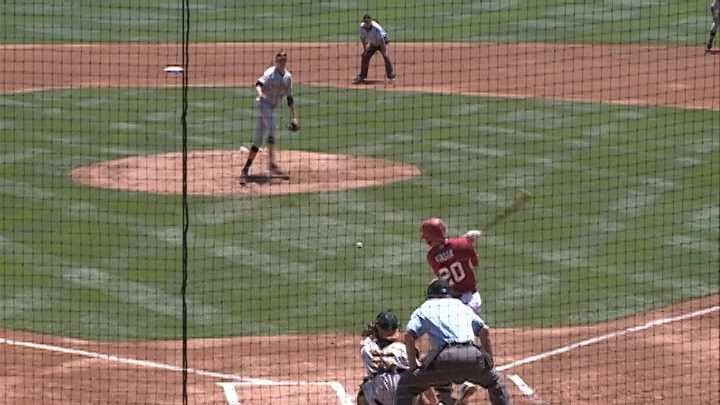 Matt Vinson hits an RBI single up the middle in the first inning to score Arkansas' first run.