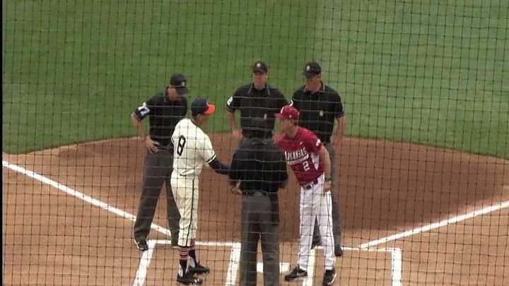 Arkansas head coach Dave Van Horn shakes hands with Auburn head coach John Pawlowski before Saturday's game.
