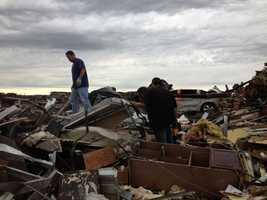 Cleaning up debris in Moore, Okla.