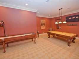 The game room has plenty of space to invite the buddies over and have a good time.