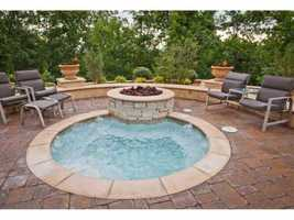 The hot tub surrounded by nature is a great escape in the summer or winter.