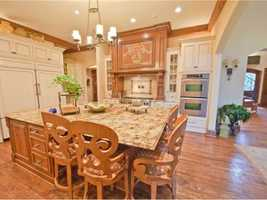 The spacious kitchen is great for cooking and gathering the family for an afternoon snack.