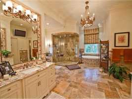 The master bathroom is big enough that the entire family could get ready in the morning.