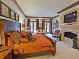 The master will never want to leave this bedroom, complete with fireplace and patio access.