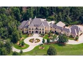 This colossal 14,700 square foot home is nestled on 3.8 acres on the northern edge of Fayetteville.
