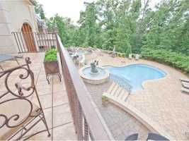 The giant rocked patio and backyard surrounded by trees provides the perfect space for pool parties with lots of friends or tranquil sunbathing on the day off.