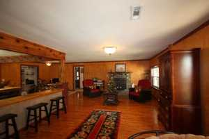 Complete with a fire place, the guest house sitting room is a great place to enjoy company by the warmth of a fire.