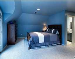 Walk-out doors, crafty ceilings, and an en suite bathroom define this beautiful room.