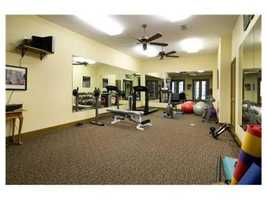 This gym with full-length mirrors, ceiling fans, and large square-footage is the perfect place to get fit!