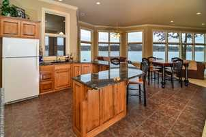 Easy access, beautiful view. This kitchen and dining area makes the perfect combo.
