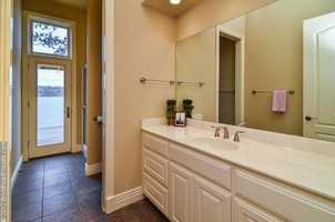 A simple but elegant bathroom adds class to this Bella Vista home.