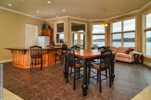 The format of this dining space will make for wonderful summer time family dinners.