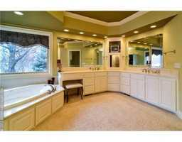 A nice, textured bathroom continues the modern design of the house.