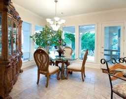 Elegant 4 person dining area, ties the kitchen space together.