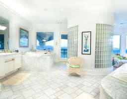 Check out this gorgeous master bath! It is one of seven in this home.