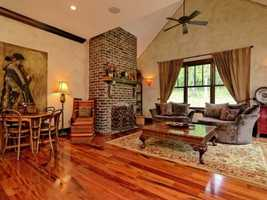 The den, dining and kitchen areas are complete with Brazillian koa hardwood floors.