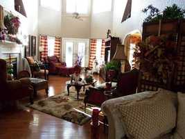 The large living room complete with a fire place is cozy yet big enough to entertain any guests.