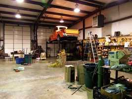 The workshop off to the side of the house has an office space as well as expansive open space to work on large farm vehicles.
