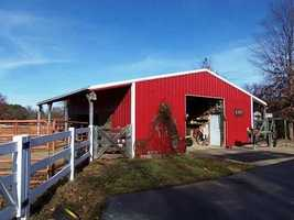The barn with an adjoining corral is a great place to store farm equipment and work with animals.
