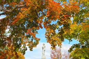 Fall color surrounds the Confederate Memorial on the Bentonville Square.