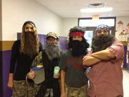 Fourth grade teachers Kim Hall, Carrie Alexander, Misty Enger, and Billie Luman dress up like characters from Duck Dynasty at Heavener Elementary school.