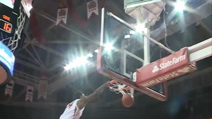 Michael Qualls throws down a one-handed slam against SIU-Edwardsville at Bud Walton Arena.