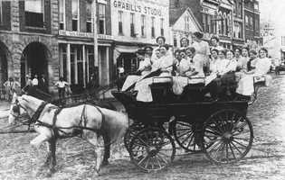 Sorority girls on a horse and dray in about 1913.