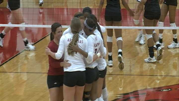 The Arkansas volleyball team celebrates a set win at Barnhill Arena.