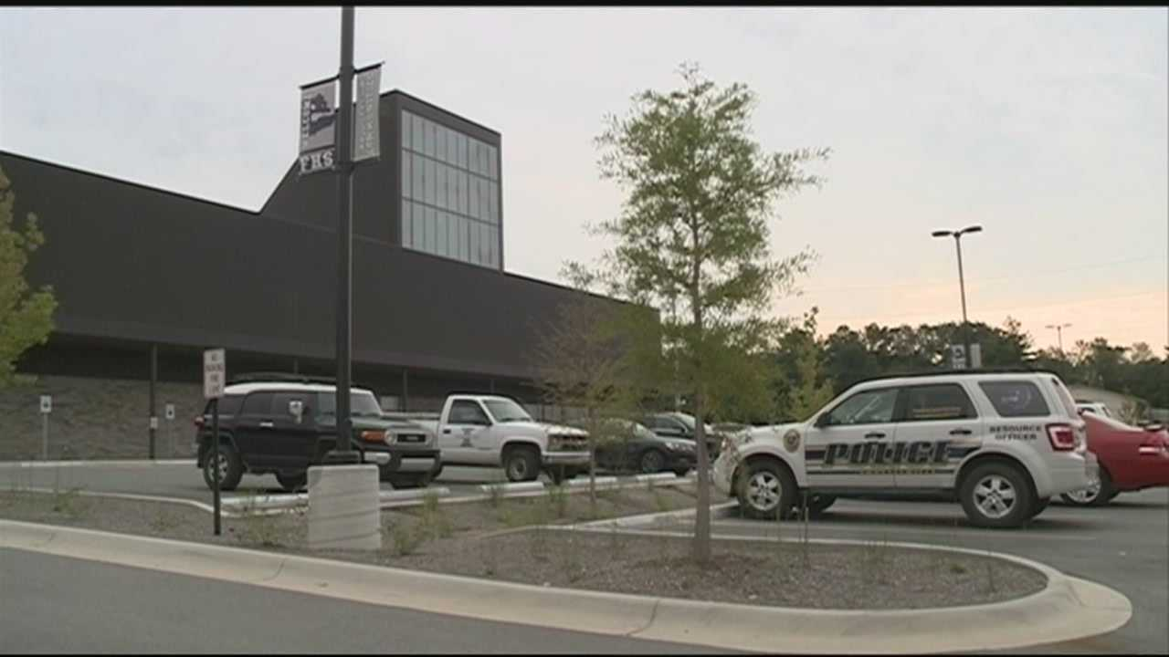 School officials say extra security will be on hand after a bomb threat was discovered in one of the high school bathrooms.