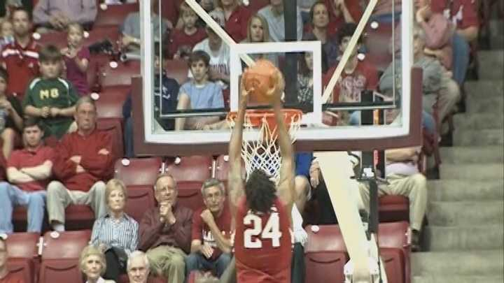 Michael Qualls slams a rebound off a Fred Gulley missed layup versus Alabama.