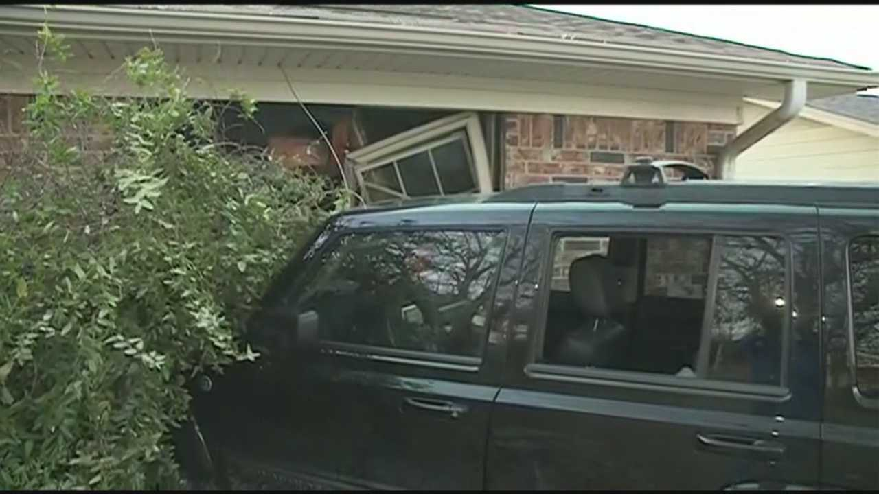 Man injured after driving his car into a house