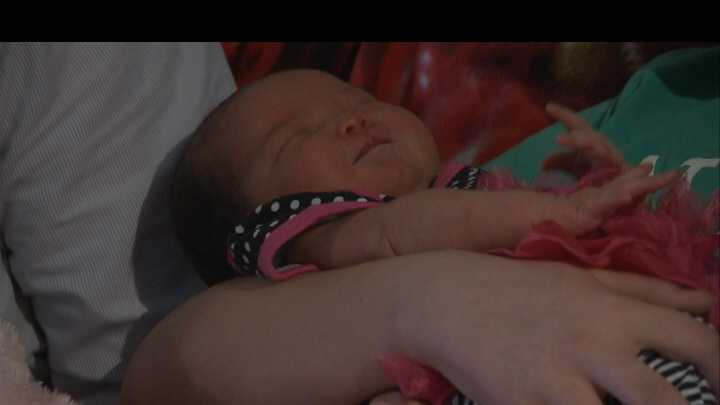 Rogers woman gives birth standing up in hospital bathroom