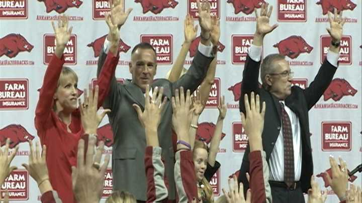 Arkansas women's basketball head coach Jimmy Dykes calls the Hogs with his family, athletic director Jeff Long and Fannie Long