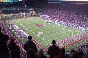 Question: How many games did the Razorbacks tie under coach Frank Broyles?