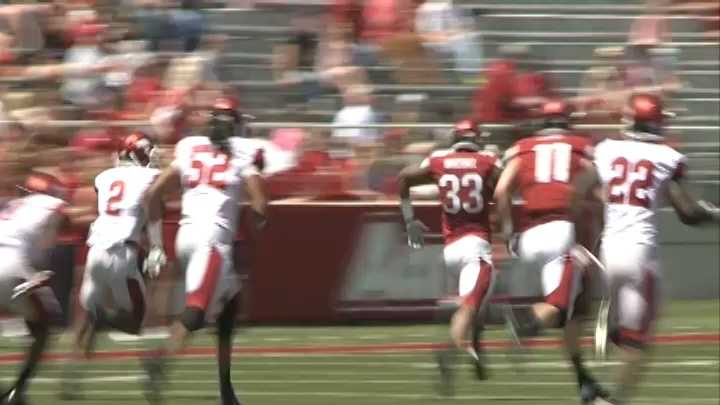 Sophomore running back Korliss Marshall breaks through the defense for a touchdown during the Red-White Game at Razorback Stadium.