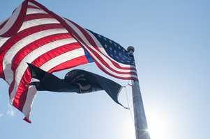 1. Fly the American flag or a POW/MIA flag.