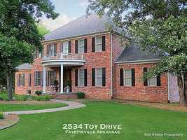 2534 Toy Drive, Fayetteville, AR - Beautiful home situated on large tree-shaded lot with great outdoor entertaining space. This home features volume ceilings & great attention to detail that is evident in C&S Custom Homes. Large living room that opens onto back deck with view of yard. Spacious kitchen with abundance of cabinets & large cooking space. Master bedroom is downstairs & four bedrooms are upstairs. This is a must see!
